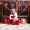 Baby Girl with red & gold baubles for Christmas mini session