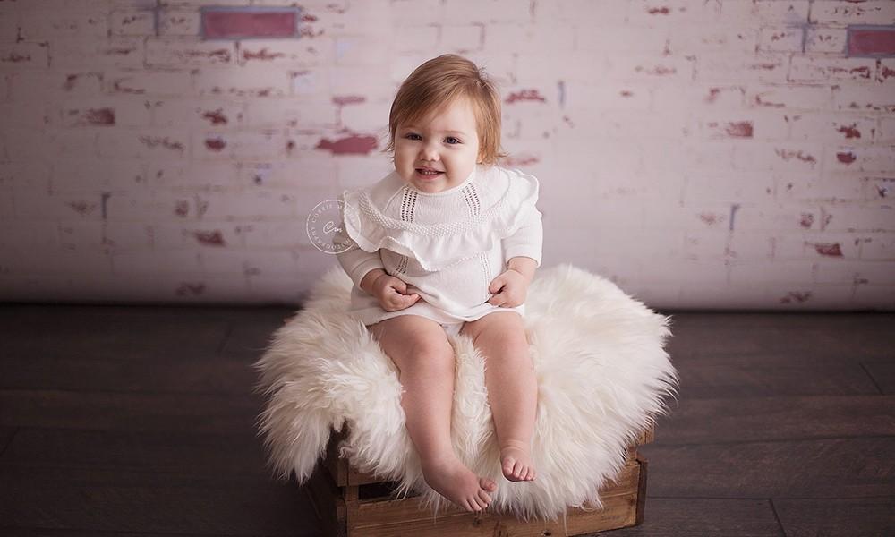 Peeling White Brick Backdrop with smiling toddler
