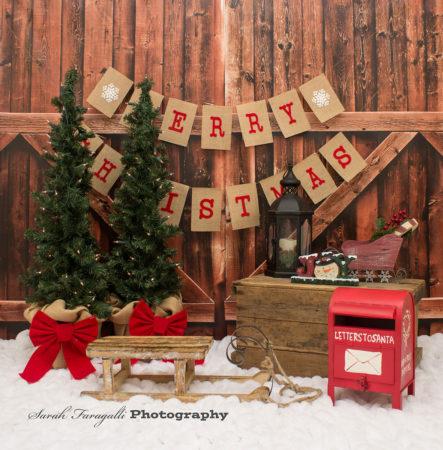Christmas themed Photography Backdrop set up with sleigh & santa mailbox