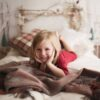 Birch Headboard Backdrop with young girl smiling on bed prop