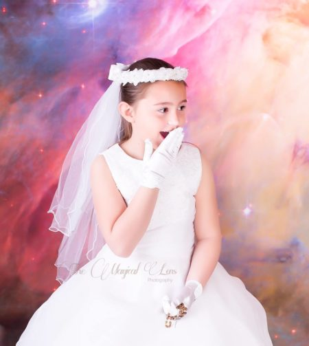 Young Girl in Confirmation Dress with Galaxy Backdrop