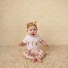 Baby girl sitting in front of Elegant Tiles Photography Backdrop