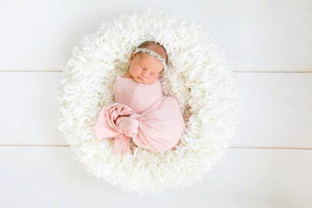 Sleeping Newborn in posing bowl