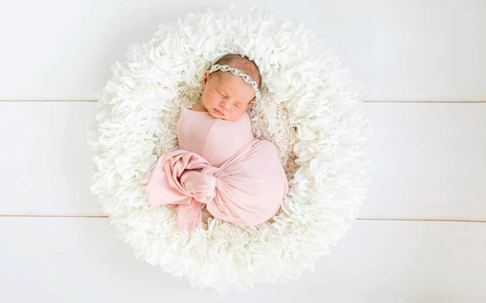 Sleeping Newborn in posing bowl