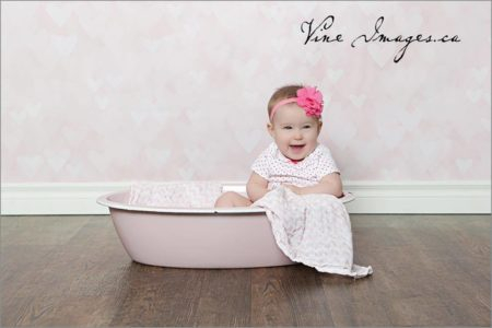 Pink Bokeh Backdrop with little girl in bathtub
