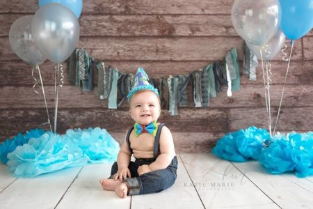 Brown Wooden Planks Backdrop with young boy smiling with balloons