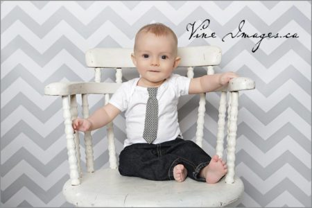 Chevron Grey Backdrop with little boy sitting in chair