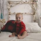 Birch Headboard Backdrop with Baby Sitting on Bed