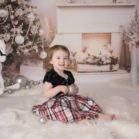 Christmas photoshoot in front of fireplace backdrop