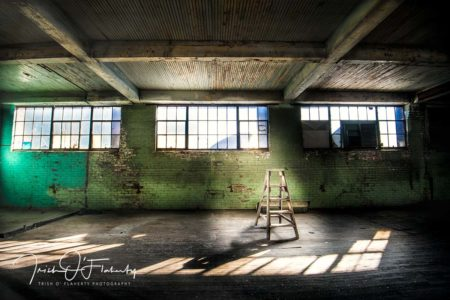 Abandoned Factory Backdrop featuring a ladder in the middle of a dark room