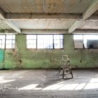 Abandoned Factory Backdrop featuring a ladder in the middle of a room