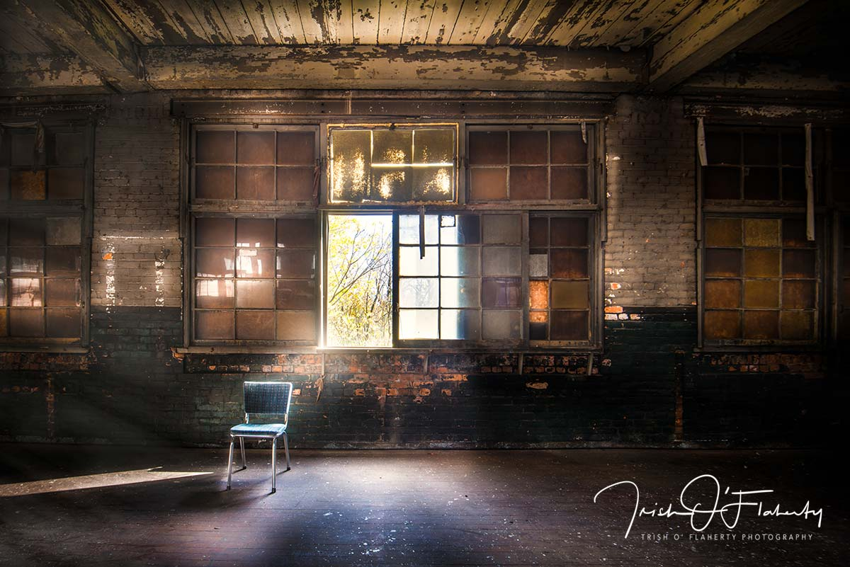 Single Chair in an Abandoned Warehouse