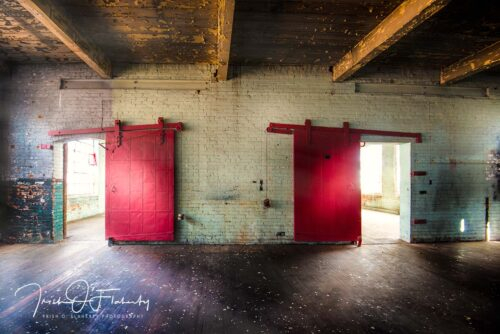2 Red Sliding Barn Doors in an Abandoned Warehouse