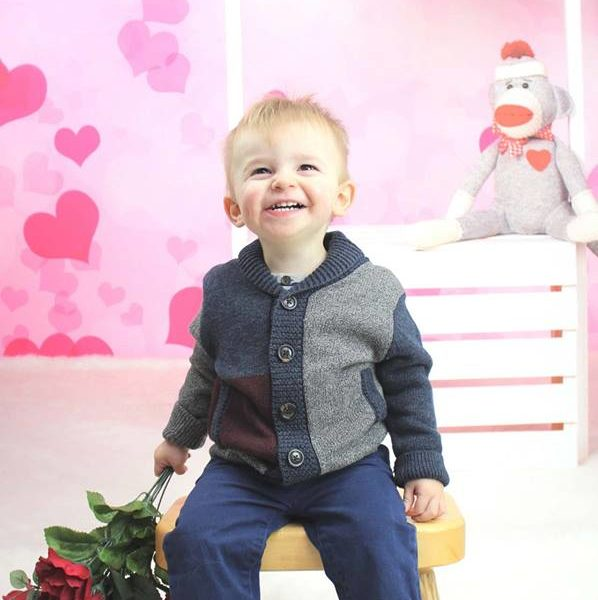 Valentine's Day Kisses Booth Backdrop with Little Boy holding Roses