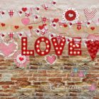 Brick Valentine's Day Backdrop with pink & red banners