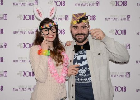 Couple with Props for New Year's Eve Party Media Wall