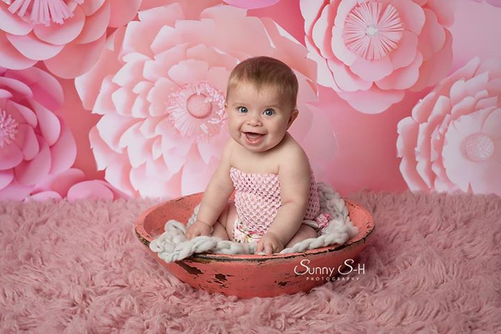 Baby posing in front of Pink Flowers Backdrop