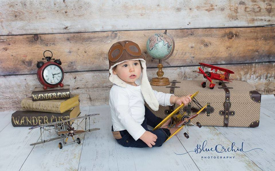 Aviator themed photoshoot with Old Barn Wood Backdrop