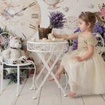 Tea Time Photoshoot with little girl drinking tea with teddy bear