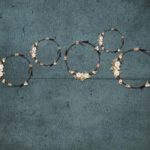 Floral Wreaths Backdrop on Textured Blue Background