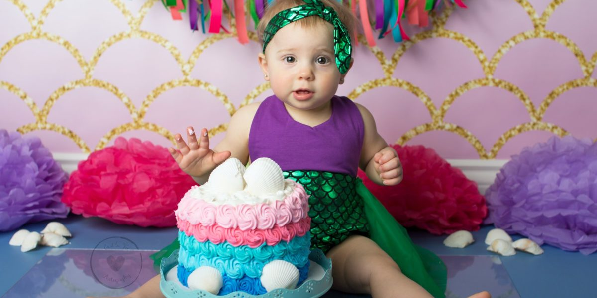 Little Girl's Cake Smash with Mermaid Tail Backdrop