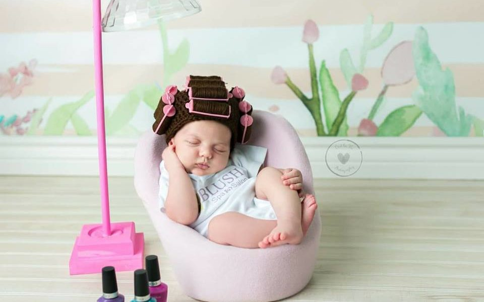 Photography Backdrop with Newborn wearing wig with hair curlers