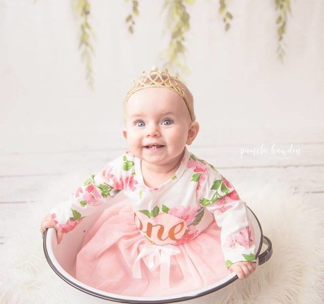 Photo Session with Baby Girl sitting in bowl with floral swag backdrop