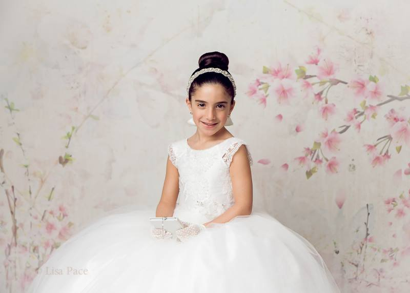 First Holy Communion Photo Shoot with Floral Backdrop Suzaane Light
